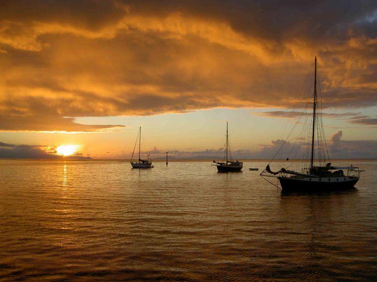 Three sunset ships