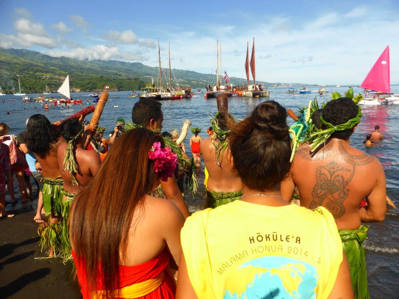 Polynesian Voyaging Society outriggers from Hawaii visiting Tahiti.